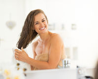 Happy young woman wiping hair with towel Royalty Free Stock Photography