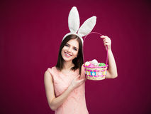 Free Happy Young Woman With An Easter Egg Basket Royalty Free Stock Image - 52297696