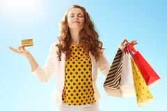 Free Happy Young Woman With Shopping Bags And Credit Card Doing Yoga Stock Image - 121854151