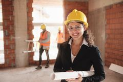 Happy Young Woman Working As Architect In Construction Site royalty free stock photography