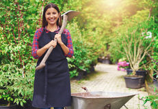 Happy young woman working at a commercial nursery Stock Photography