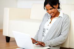 Happy young woman working on laptop Royalty Free Stock Photo