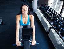 Happy young woman working out on a simulator Royalty Free Stock Photography