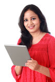 Happy young woman working with tablet computer against white Stock Photo