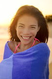 Happy Young Woman Wrapped In Towel At Beach Stock Image