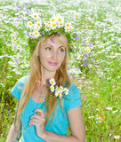The happy young woman in a wreath from wild flower Royalty Free Stock Images