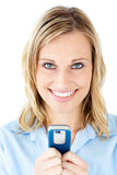 Happy young woman writing a message on her phone Royalty Free Stock Photo