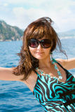 Happy young woman on yacht in the sea Stock Photo