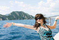 Happy young woman on yacht in the sea Stock Image
