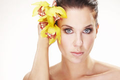 Happy young woman with yellow flower Stock Photos