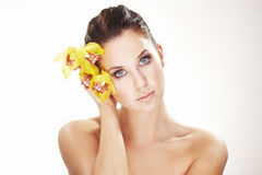 Happy young woman with yellow flower Royalty Free Stock Photo