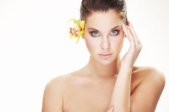 Happy young woman with yellow flower Royalty Free Stock Images
