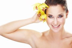 Happy young woman with yellow flower Stock Photo