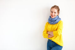 Happy young woman in yellow sweater on white background royalty free stock photos