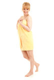 Happy young woman in yellow towel Royalty Free Stock Image