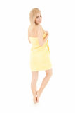 Happy young woman in yellow towel Stock Photo
