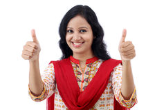 Happy young womanmaking thumbs up sign Stock Photography