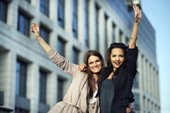 Happy young women. Two beautiful young women celebrating sucess Stock Photography