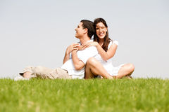 Happy young women with arms around her husband Stock Photos