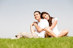 Happy young women with arms around her husband stock images
