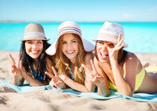Happy young women in bikinis on summer beach Stock Photography