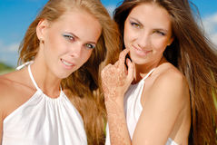 Happy young women with bright makeup Stock Photos