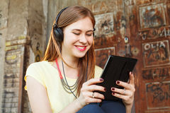 Happy young women chat via Tablet PC Royalty Free Stock Photo