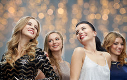 Happy young women dancing at holidays party. Party, holidays, nightlife and people concept - happy young women dancing at party or disco over lights background Royalty Free Stock Image