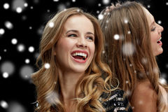 Happy young women dancing at night club disco. New year party, christmas, winter holidays and people concept - happy young women dancing at night club disco over Royalty Free Stock Image