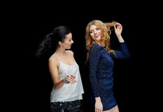 Happy young women dancing at night club disco Royalty Free Stock Photos