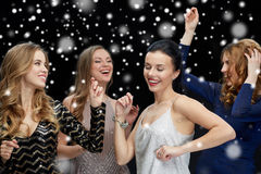 Happy young women dancing at night club disco Stock Images