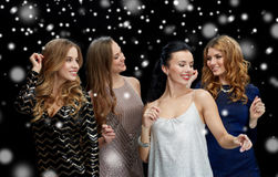 Happy young women dancing at night club disco. Party, holidays, nightlife and people concept - happy young women dancing at night club disco over black Royalty Free Stock Photos