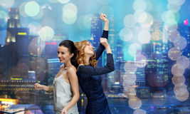 Happy young women dancing at night club disco Stock Image