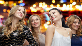 Happy young women dancing at night club disco Stock Photo