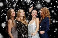 Happy young women dancing over snow Stock Image