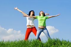 Happy young women dreams to fly on winds Stock Images