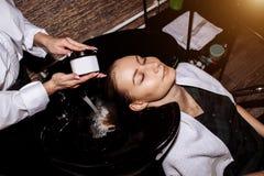Beautiful woman washing hair in a hair salon royalty free stock image