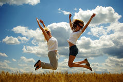 Happy young women on field in summer Royalty Free Stock Photo