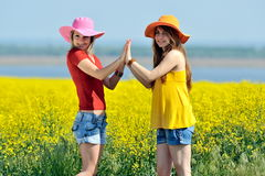 Happy young women on field in summer Royalty Free Stock Image