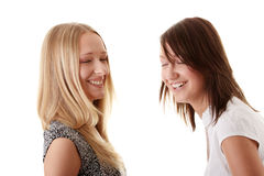Happy young women friends laughing Royalty Free Stock Images