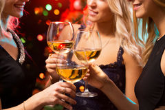 Happy young women with glasses of champagne. Royalty Free Stock Images