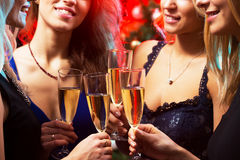 Happy young women with glasses of champagne Stock Photography