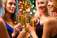 Happy young women with glasses of champagne Royalty Free Stock Photos