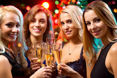 Happy young women with glasses of champagne Royalty Free Stock Photo