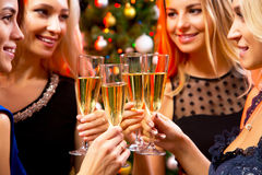 Happy young women with glasses of champagne Royalty Free Stock Images