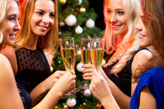 Happy young women with glasses of champagne Stock Photo