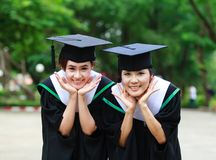 Happy young women graduate students Stock Images