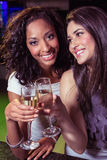 Happy young women having champagne Royalty Free Stock Image