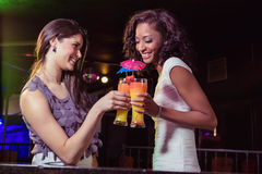 Happy young women having cocktail Stock Photo