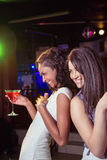 Happy young women having red cocktail Stock Photos